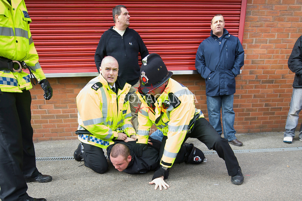 MANCHESTER, ENGLAND - Saturday, March 14, 2009: Greater Manchester Police use excessive force on a football supporter before the Premiership match between Manchester United and Liverpool at Old Trafford. (Photo by David Rawcliffe/Propaganda)
