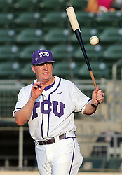 TCU head coach Jim Schlossnagle takes infield practice with his team before the start of a NCAA college baseball Super Regional tournament game against Texas A&M, Saturday, June 11, 2016, in College Station, Texas. Texas A&M won 7-1 to even the series at 1-1. (AP Photo/Sam Craft)