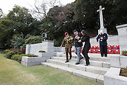 Ex-Japanese prisoner of War, Roy Welland (94) is helped down the steps of the Cross of Sacrifice after laying a wreath during the Remembrance Day ceremonies at the Commonwealth War Cemetery in Hodogaya, Yokohama, Japan. Wednesday November 11th 2015