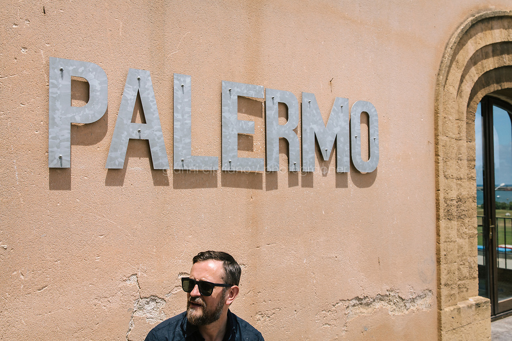 PALERMO, ITALY - 15 JUNE 2018: Artist John Gerrard is seen here on the terrace of Palazzo Forcella De Seta during Manifesta 12, the European nomadic art biennal, in Palermo, Italy, on June 15th 2018.<br /> <br /> Manifesta is the European Nomadic Biennial, held in a different host city every two years. It is a major international art event, attracting visitors from all over the world. Manifesta was founded in Amsterdam in the early 1990s as a European biennial of contemporary art striving to enhance artistic and cultural exchanges after the end of Cold War. In the next decade, Manifesta will focus on evolving from an art exhibition into an interdisciplinary platform for social change, introducing holistic urban research and legacy-oriented programming as the core of its model.<br /> Manifesta is still run by its original founder, Dutch historian Hedwig Fijen, and managed by a permanent team of international specialists.<br /> <br /> The City of Palermo was important for Manifesta&rsquo;s selection board for its representation of two important themes that identify contemporary Europe: migration and climate change and how these issues impact our cities.