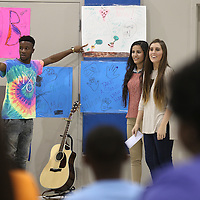 Adam Robison | BUY AT PHOTOS.DJOURNAL.COM<br /> Tupelo High School Seniors, Jeremy Hinds, Lillian Salem and Jordan Tarter, lead children at the Boys and Girls Club in a anti bullying program as they look over the anti bulling posters the children made Tuesday afternoon in Tupelo. The program was part of their senior project