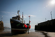 Opportunity (FE 6) a Folkestone registered Fishing boats sit on the sand in a dry harbour entrance  due to the tide being out, waiting for the tide to come back in. Folkestone Harbour, Kent, United Kingdom. (photo by Andrew Aitchison / In pictures via Getty Images)