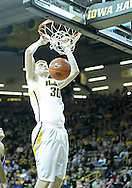 December 17, 2011: Iowa Hawkeyes forward Aaron White (30) dunks the ball during the the NCAA basketball game between the Drake Bulldogs and the Iowa Hawkeyes at Carver-Hawkeye Arena in Iowa City, Iowa on Saturday, December 17, 2011. Iowa defeated Drake 82-68.