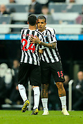 Jose Salomon Rondon (#9) of Newcastle United embraces Miguel Almiron (#24) of Newcastle United as he is substituted during the Premier League match between Newcastle United and Huddersfield Town at St. James's Park, Newcastle, England on 23 February 2019.