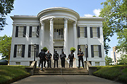"""6/6/2020 Jackson MS. <br /> Pictured is Laila Williams, 21, with her fist in the air outside the Governors mansion in after a peaceful protest by Black Lives Matter.  She spoke of a change that is sweeping across the world, to end systematic racism and police brutality. As a black woman  in America she said how could she not be there in support.<br /> <br /> Protestors of all ages and races gathered out side the Governor Mansion after a peaceful protest by Black Lives Matter, organized by 18 yr old student Maisie Brown.   As the crowd chanted """"I can't breathe """" check his pulse.""""   and """" justice for George Floyd, in addition to """" no justice No Peace in the 90 degree heat. Photo© Suzi Altman<br /> <br /> Student Maisie Brown 18yrs old from Jackson organized a peaceful protest outside the Governors Mansion. She said there voices would be heard and her face would be seen- change is coming. The protest was in honor of George Floyd and in support of ending systematic racism and to end police brutality in Mississippi and America. The National Black Panthers Party from Tupelo Mississippi showed up outside the Governors mansion in the shadow of the State Capitol to protest police brutality. The National Black Panthers Party was their to show their support for change in Mississippi, to end systemic racism and police brutality. Protests have broken out around the world in solidarity to end white supremacy and police brutality. The Panthers showed up at the end of a peaceful protest organized by 18yr old student Maisie Brown. The brutal murder of African American George Floyd by the knee and hands of 4 former Minneapolis Minnesota police officers has sparked a cry for justice and reform around the world. Photo copyright © Suzi Altman @suzialtman #mississippi #blm #blacklivesmatter #protest #icantbreathe #georgefloyd #endracism #policebrutality #documentary #history #suzialtman #iphonography #shotoniphone #zumapress #NBPP #panthers #blackpanthers #nationalblackpantherparty"""