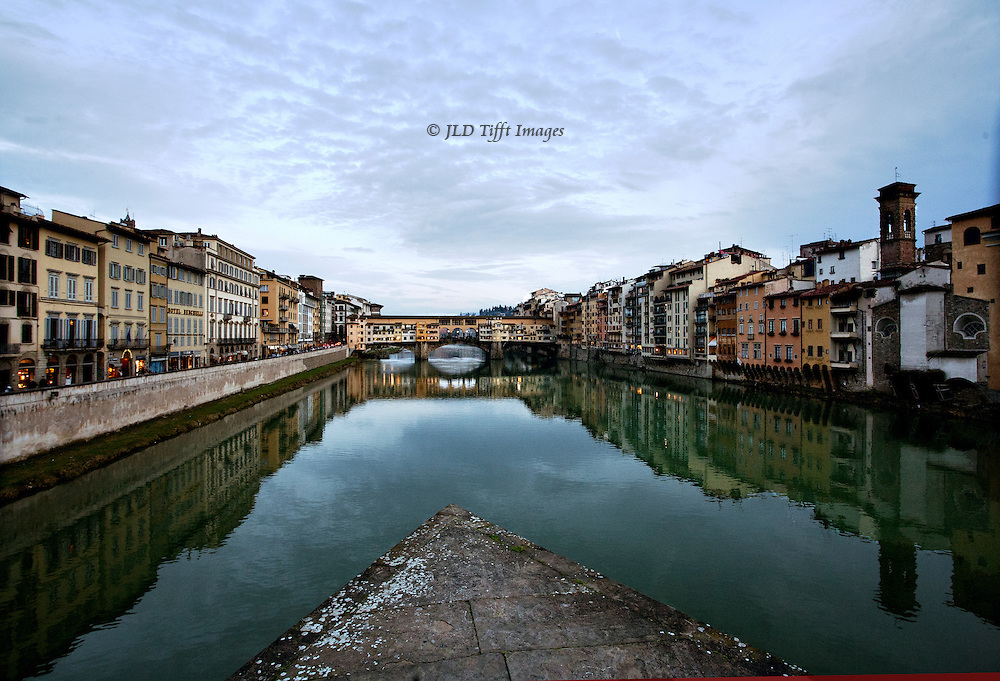 A wide angle view of Florence along the Arno, that includes a support of the Ponte S. Trinita