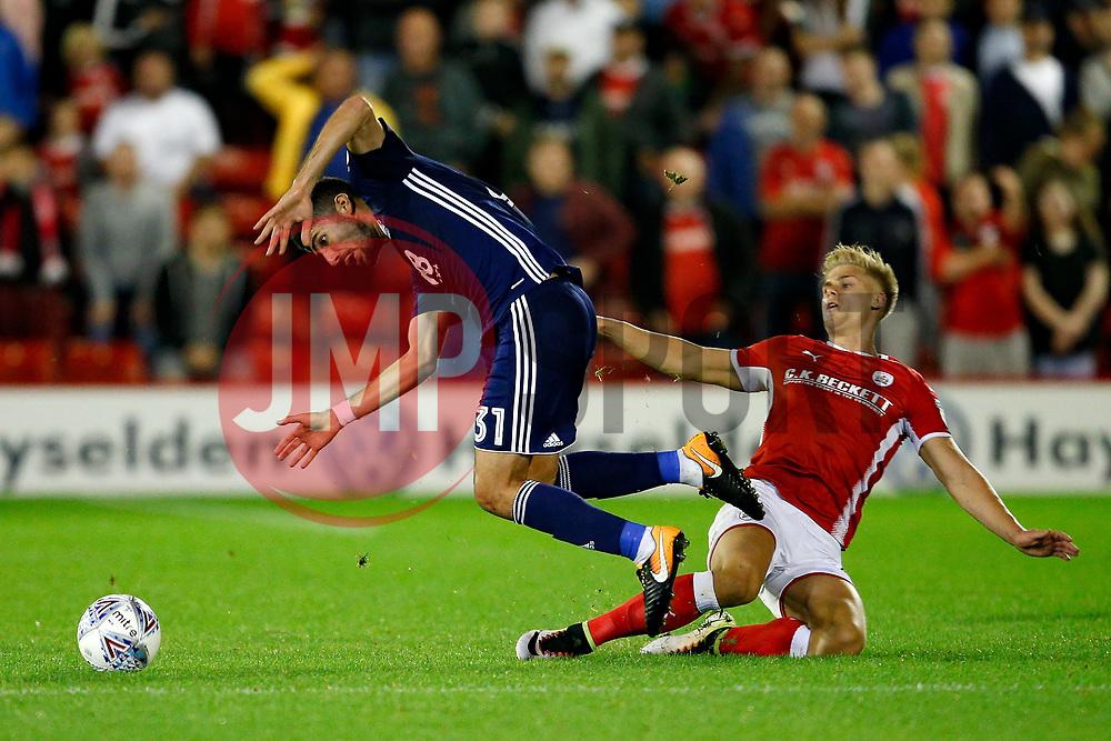 Barnsley's Brad Potts fouls Nottingham Forest's Andreas Bouchalakis - Mandatory by-line: Matt McNulty/JMP - 15/08/2017 - FOOTBALL - Oakwell Stadium - Barnsley, England - Barnsley v Nottingham Forest - SkyBet Championship