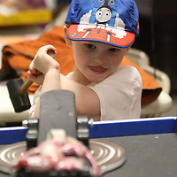 James Elmore, 4, plays a game of Leaping Lizards Saturday during the Dudie Burger Festival at the Oren Dunn Museum
