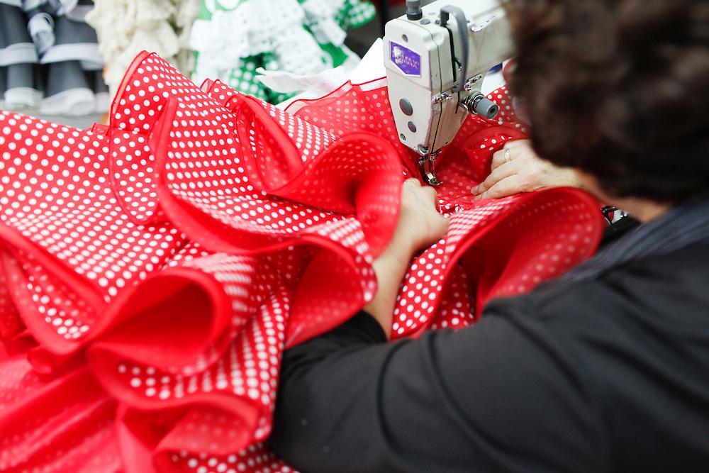 Abril, 17, 2010. Lifestyle/Spain. Seville April Fair. The clothing firm of flamenco dresses Maricruz.