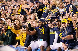 Nov 4, 2017; Morgantown, WV, USA; West Virginia Mountaineers players celebrate with fans after the game at Milan Puskar Stadium. Mandatory Credit: Ben Queen-USA TODAY Sports