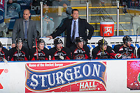 KELOWNA, CANADA - FEBRUARY 9: Head coach Mark Holick of Prince George Cougars stands on the bench against the Kelowna Rockets on February 9, 2015 at Prospera Place in Kelowna, British Columbia, Canada.  (Photo by Marissa Baecker/Shoot the Breeze)  *** Local Caption *** Mark Holick;