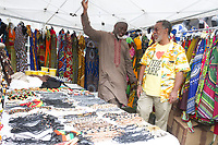 """The Harambee Art and Craft Music Festival celebrated its seventh year in Chicago Sunday morning as participants were treated to arts, crafts and performances from all over the world. The event was held on 53rd Street in front of Nichols Park located at 1355 E. 53rd Street.<br /> <br /> 8814 – Vendor, Muhamed Kebbeh speaks with Executive Director of the Hyde Park Chamber of Commerce, Wallace Goode.<br /> <br /> Please 'Like' """"Spencer Bibbs Photography"""" on Facebook.<br /> <br /> Please leave a review for Spencer Bibbs Photography on Yelp.<br /> <br /> All rights to this photo are owned by Spencer Bibbs of Spencer Bibbs Photography and may only be used in any way shape or form, whole or in part with written permission by the owner of the photo, Spencer Bibbs.<br /> <br /> For all of your photography needs, please contact Spencer Bibbs at 773-895-4744. I can also be reached in the following ways:<br /> <br /> Website – www.spbdigitalconcepts.photoshelter.com<br /> <br /> Text - Text """"Spencer Bibbs"""" to 72727<br /> <br /> Email – spencerbibbsphotography@yahoo.com"""