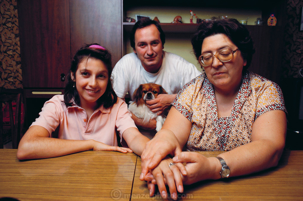 "(1992) Paula Moyano Artiga sits with her grandmother and Uncle Efrain. She was born in captivity and reunited to her family by DNA fingerprinting. Her parents, both ""desaparacidos"" (disappeared persons, kidnapped and killed by the right-wing Argentine government), are still missing. Buenos Aires, Argentina. DNA Fingerprinting. MODEL RELEASED."