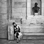 John M. Carrère, the architect of The New York Public Library , keeps a watchful eye over the dreamy lady on his bench.