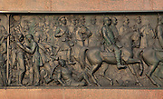 Relief scene, 1870-71 by Karl Keil, of the Prussian army in battle from the base of the Siegessaule or Berlin Victory Column, designed by Heinrich Strack and inaugurated 1873 to celebrate the victories of the Prussian army in the Danish-Prussian war, Austro-Prussian war and Franco-Prussian war, at the Grosser Stern, Grosser Tiergarten Park, Berlin, Germany. The monument takes the form of a column topped by a giant gilded bronze statue of Victoria by Friedrich Drake and a hall of red granite pillars below with a glass mosaic designed by Anton von Werner and reliefs around the base. Picture by Manuel Cohen