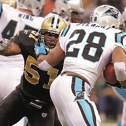 2008 December, 28: New Orleans Saints linebacker Jonathan Vilma (51) goes in to tackle Carolina Panthers running back Jonathan Stewart (28) during a week 17 game between NFC South divisional rivals the Carolina Panthers and the New Orleans Saints at the Louisiana Superdome in New Orleans, LA.