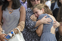 September 11, 2016 - Arlington, VA, United States of America - Rachael Fisher, 12, reacts during a remembrance ceremony commemorating the 15th anniversary of the 9/11 terrorist attacks at the Pentagon September 11, 2016 in Arlington, Virginia. Fishers grandfather, Gerald Fisher, died during the attacks on the Pentagon. (Credit Image: © Tsgt. Brigitte N. Brantley/Planet Pix via ZUMA Wire)