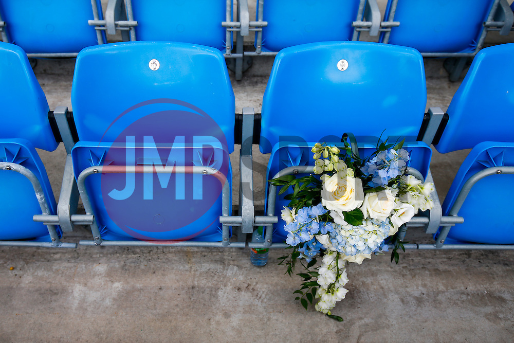 Flowers are left in the empty seat of a recently deceased Manchester City season ticket holder as a mark of respect - Photo mandatory by-line: Rogan Thomson/JMP - 07966 386802 - 30/08/2014 - SPORT - FOOTBALL - Manchester, England - Etihad Stadium - Manchester City v Stoke City - Barclays Premier League.