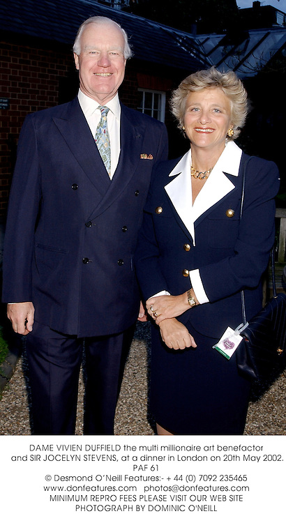 DAME VIVIEN DUFFIELD the multi millionaire art benefactor and SIR JOCELYN STEVENS, at a dinner in London on 20th May 2002.	PAF 61