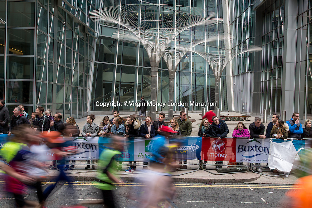 Athletes run along North Colonnade at Canary Wharf where the 30k marker point is. The Virgin Money London Marathon, Sunday 24th April 2016.<br /> <br /> Photo: Dillon Bryden for Virgin Money London Marathon<br /> <br /> For more information please contact media@londonmarathonevents.co.uk