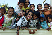 Indian children in back of TATA truck at Mehrauli, New Delhi, India