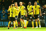 Burton Albion midfielder Scott Fraser (7) shoots and scores a goal and celebrates 1-0  during the EFL Cup match between Burton Albion and Nottingham Forest at the Pirelli Stadium, Burton upon Trent, England on 30 October 2018.
