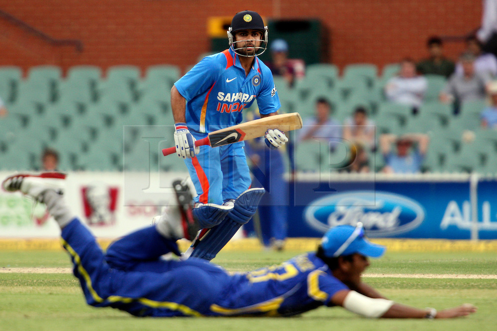 © Licensed to London News Pictures. 14/02/2012. Adelaide Oval, Australia. Virat Kohli looks on as the fielder dives in an attempt to save the ball from going for four during the One Day International cricket match between India Vs Sri Lanka. Photo credit : Asanka Brendon Ratnayake/LNP