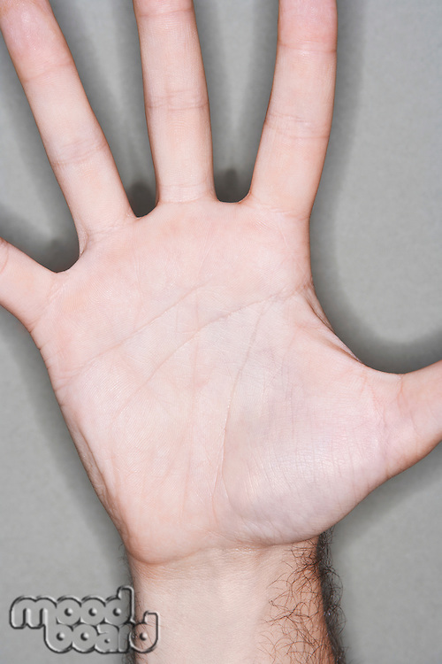 Man displaying outstretched hand close-up on palm of hand
