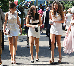 Racegoers  at Ladies Day at Glorious Goodwood in the UK  Thursday, 1st August 2013<br /> Picture by Stephen Lock / i-Images