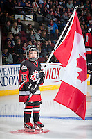 KELOWNA, CANADA - NOVEMBER 9: Cooper Vogt skates with the Russian flag during opening ceremonies  on November 9, 2015 during game 1 of the Canada Russia Super Series at Prospera Place in Kelowna, British Columbia, Canada.  (Photo by Marissa Baecker/Western Hockey League)  *** Local Caption *** Cooper Vogt;