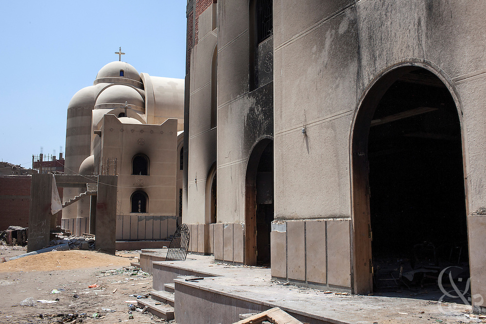 The Virgin Mary Church compound lies looted and burned August 20, 2013 in the village of Nazla, located near el Fayoum, around a 100 kilometers South of Cairo, Egypt.  Christian villagers report 2 churches and a monastery in the area came under attack by their Muslim neighbors on the same day as Egyptian security forces were moving to forcibly disperse the sit-in camp of the supporters of deposed president Mohamed Morsi.