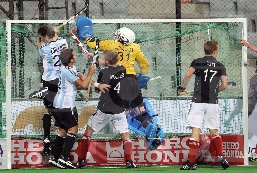 NEW DELHI - World Cup Hockey men.Germany v Argentina.Germany gewint 4-3.Jessulat kicked the bal over the goal before Facundo..Maximilian Mueller is watching.FFU Press Agency  COPYRIGHT Frank Uijlenbroek/Grant Treeby..
