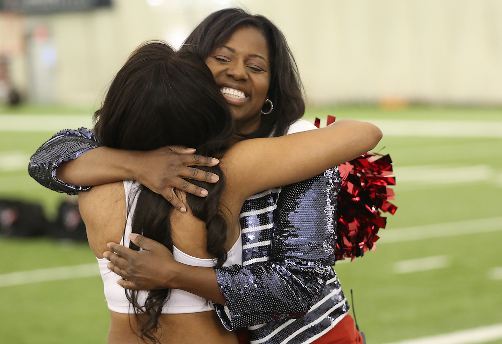 4/16/2014: Houston Texans Cheerleader Director Alto Gray hugs a new cheerleader. Fifty girls showed up on April 16, 2014 at the Houston Texans practice facility in Houston, Texas to see which 35 girls made the 2014-2015, Houston Texans Cheerleading Team.