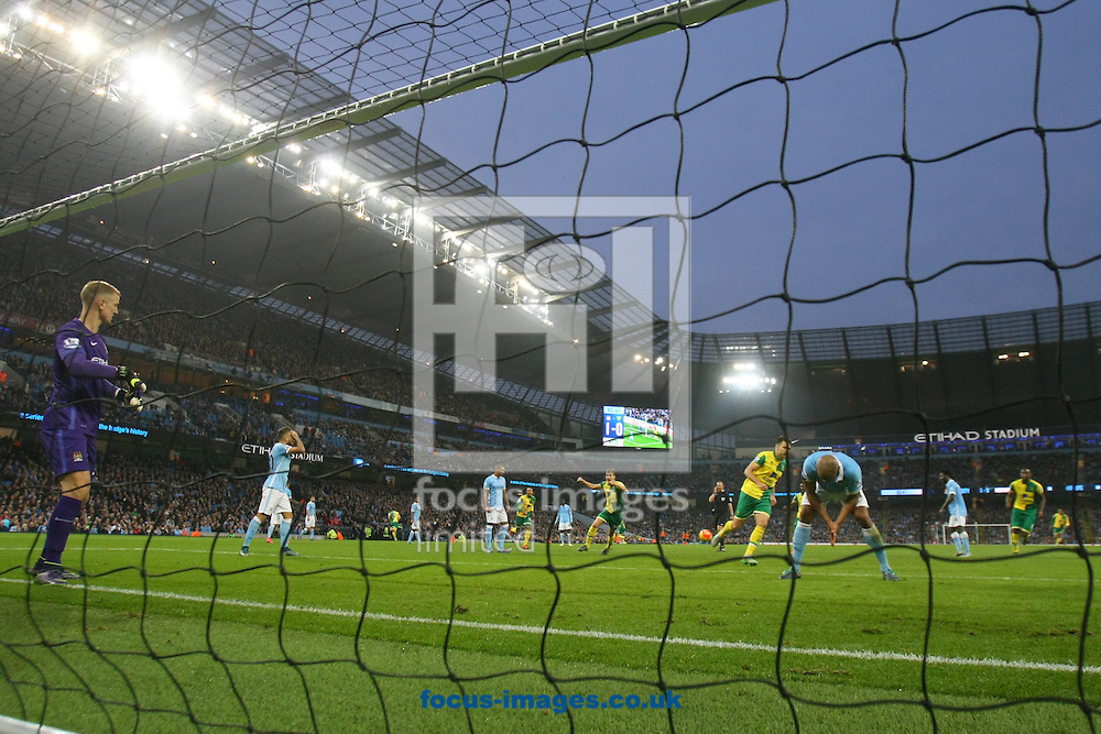 Joe Hart of Manchester City fumbles the ball and Cameron Jerome of Norwich scores his sides equalising goal during the Barclays Premier League match at the Etihad Stadium, Manchester<br /> Picture by Paul Chesterton/Focus Images Ltd +44 7904 640267<br /> 31/10/2015