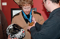 Jon Montgomery shares his gold medal win in the mens' skeleton with Tsimshian artist Philip Gray at the Black Tusk Gallery in Whistler during the 2010 Olympic Winter Games. Montgomery commissioned Gray to paint his animal totem, the Thunderbird, on his helmet. In local first nations culture the Black Tusk is considered the nest of the Thunderbird, and so was Montgomery's choice in locating an artist to create his helmet design.