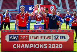 (Free to use courtesy of Sky Bet) Dion Conroy and manager Richie Wellens lift the trophy as Swindon Town gather at The County Ground to celebrate becoming Sky Bet League Two Champions, with a socially distanced trophy lift, after the curtailment of the regular season due to the Covid-19 pandemic - Rogan/JMP - 26/06/2020 - The County Ground - Swindon, England - Sky Bet League 2.