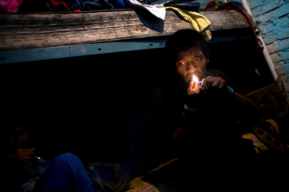 A homeless man smokes crack in Mexico City.  Drugs use has been rising in Mexico City.  Low level dealers are now paid more often in drugs instead of money, and increased border security causes more drugs to stay in the country.  In the capital many homeless children and adults are addicted to sniffing paint thinner and also to crack.