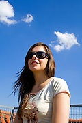 sitting brunette on blue sky