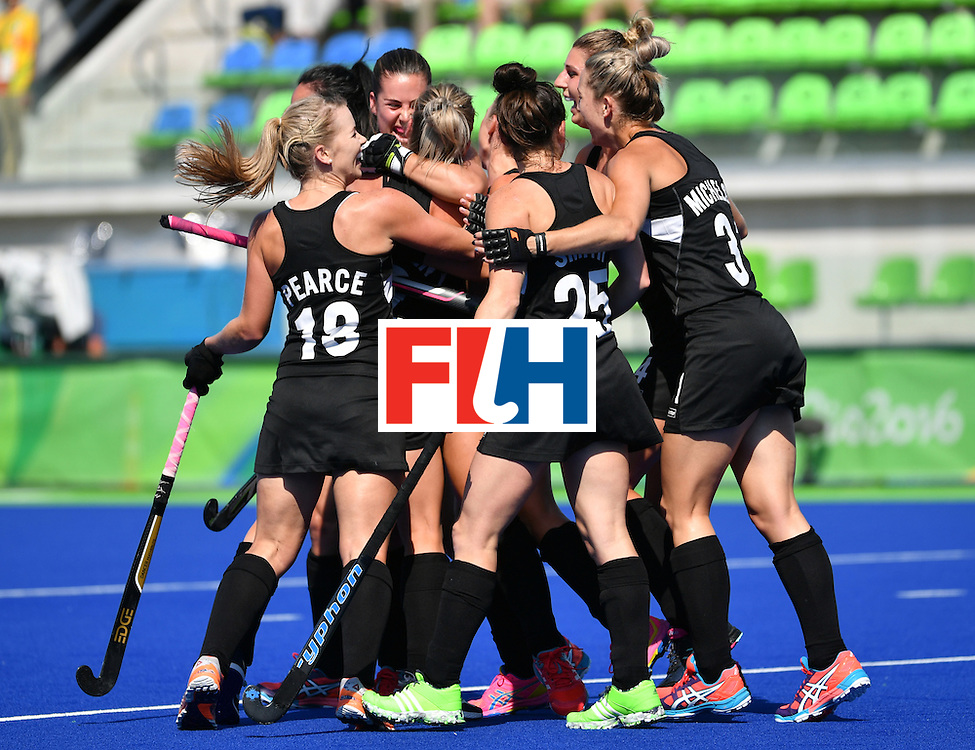 New Zealand's players celebrate their opening goal during the the women's quarterfinal field hockey New Zealand vs Australia match of the Rio 2016 Olympics Games at the Olympic Hockey Centre in Rio de Janeiro on August 15, 2016. / AFP / Pascal GUYOT        (Photo credit should read PASCAL GUYOT/AFP/Getty Images)