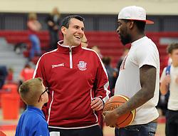Bristol Flyers head coach, Andreas Kapoulas speaks with Bristol City's Jay Emmanuel-Thomas - Photo mandatory by-line: Dougie Allward/JMP - Mobile: 07966 386802 - 27/02/2015 - SPORT - basketball - Bristol - SGS Wise Campus - Bristol Flyers v Leeds Force - British Basketball League