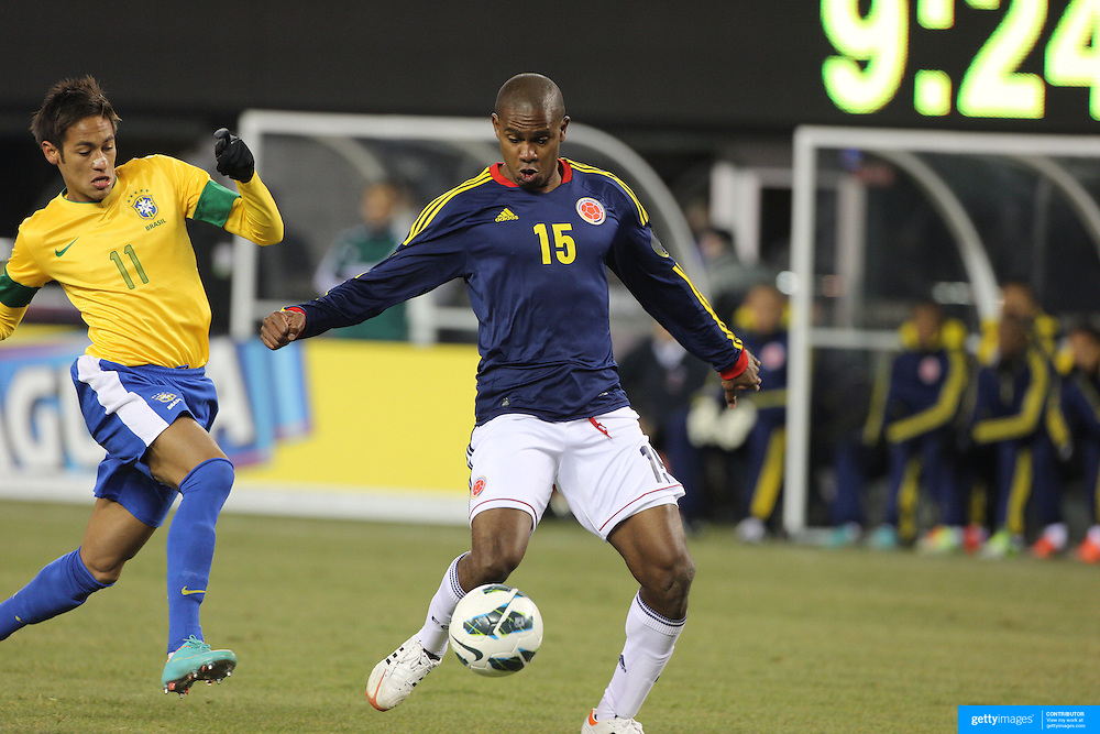 Edwin Valencia, Colombia, (right) challenged by Neymar, Brazil, during the Brazil V Colombia International friendly football match at MetLife Stadium, New Jersey. USA. 14th November 2012. Photo Tim Clayton