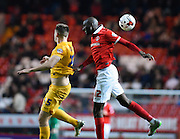 Charlton Athletic midfielder Alou Diarra and Preston North End defender Tom Clarke in an aerial battle during the Sky Bet Championship match between Charlton Athletic and Preston North End at The Valley, London, England on 20 October 2015. Photo by David Charbit.