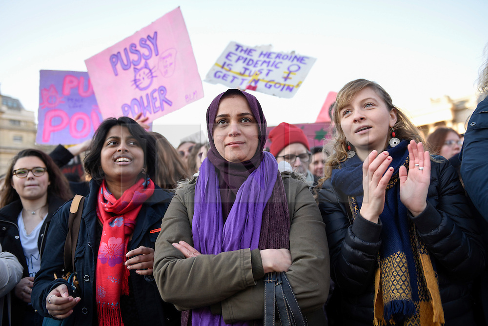 © Licensed to London News Pictures. 21/01/2017. London, UK. Women holding placards are amongst the tens of thousands of women arriving in Trafalgar Square during the Women's March in central London.  The event, alongside others taking place worldwide, is a protest against gender inequality. Photo credit : Stephen Chung/LNP