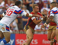 Anthony England (L) and Bill Tupou (R) of Wakefield Trinity tackles Lewis Tierney (C) of Catalans Dragons during the Betfred Super League match at the Mobile Rocket Stadium, Wakefield<br /> Picture by Stephen Gaunt/Focus Images Ltd +447904 833202<br /> 07/07/2018
