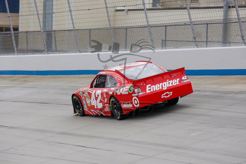 DOVER, DE - JUN 01, 2012:  Juan Pablo Montoya (42) brings his Target Chevrolet on the track for a practice session for the FedEx 400 Benefiting Autism Speaks at the Dover International Speedway in Dover, DE.