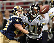 Jacksonville Jaguars defensive back Rashean Mathis (27) steps in front of St. Louis Rams wide receiver Kevin Curtis (83) for the interception in the first quarter at the Edward Jones Dome in St. Louis, Missouri, October 30, 2005.  The Rams beat the Jaguars 24-21.