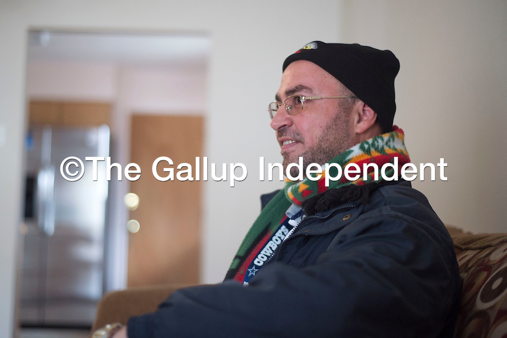 Sam Adi, a Gallup resident, talks about his opinions on President Donald Trump's executive orders banning Syrian refugees during an interview at his home in Gallup Monday.
