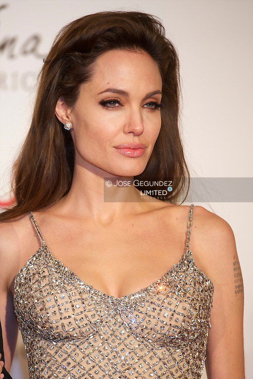 """(FILES) December 16, 2010 file photo shows US actress Angelina Jolie posing as she arrives for the premiere of her last film """"the Tourist"""" at the Palacio de Deportes of Madrid. Angelina Jolie revealed mAY 14, 2013 that she has undergone a preventive double mastectomy to reduce her risk of cancer. The American actress wrote in an opinion piece entitled """"My Medical Choice"""" in The New York Times that she had chosen the procedure because she carries a faulty gene that increases her risk of breast and ovarian cancer."""
