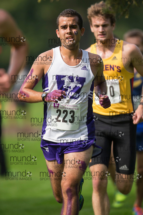 Phil Parrot-Migas of the Western Mustangs runs at the 2014 Western International Cross country meet in London Ontario, Saturday,  September 20, 2014.<br /> Mundo Sport Images/ Geoff Robins