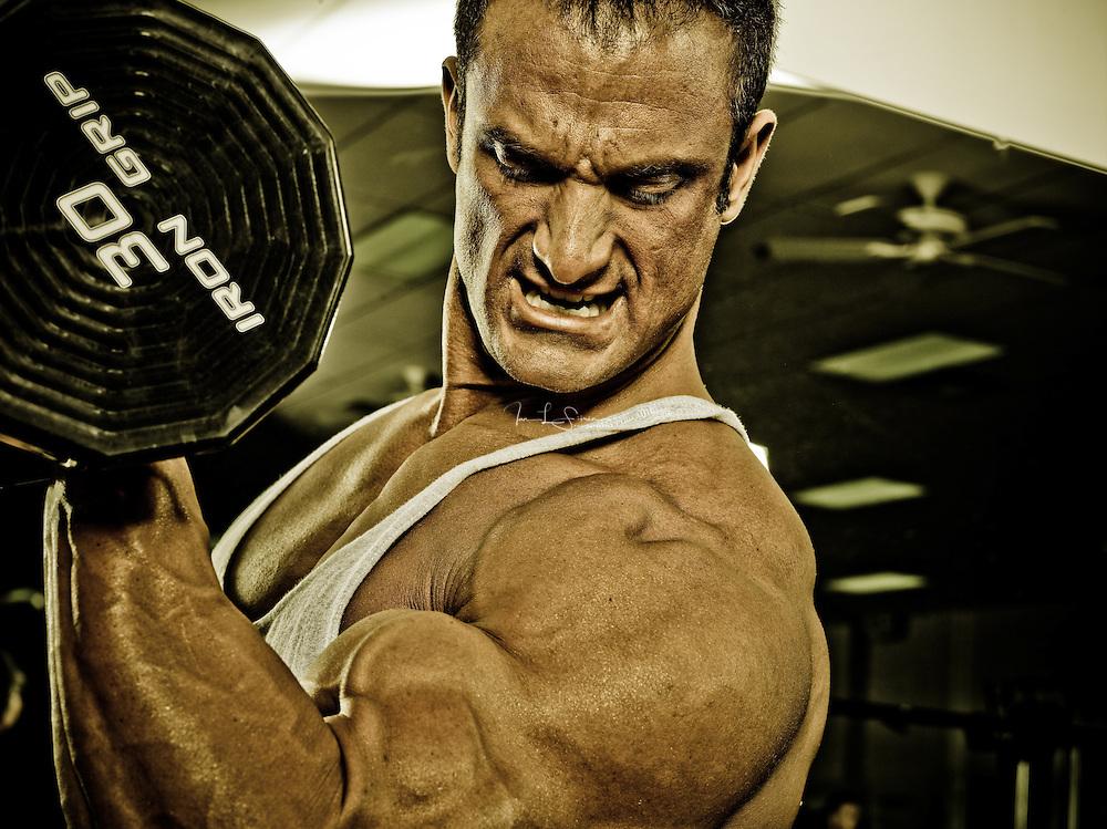 Bodybuilder Dan Decker working out in the gym.
